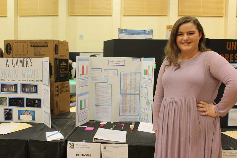 PMG PHOTO: HOLLY BARTHOLOMEW - Wilsonville High School senior Hayley Jablonowski presents her project comparing adult and adolescent memories.