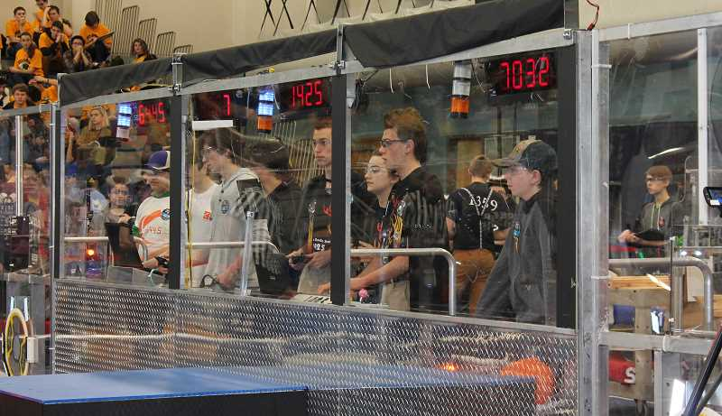 PMG PHOTO: HOLLY BARTHOLOMEW - Wilsonville High School Team 1425 Error Code Xero drives its robot during a preliminary round of the district event at WHS.