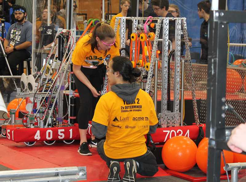 PMG PHOTO: HOLLY BARTHOLOMEW - Team 7034 2B Determined prepares its robot before a match.
