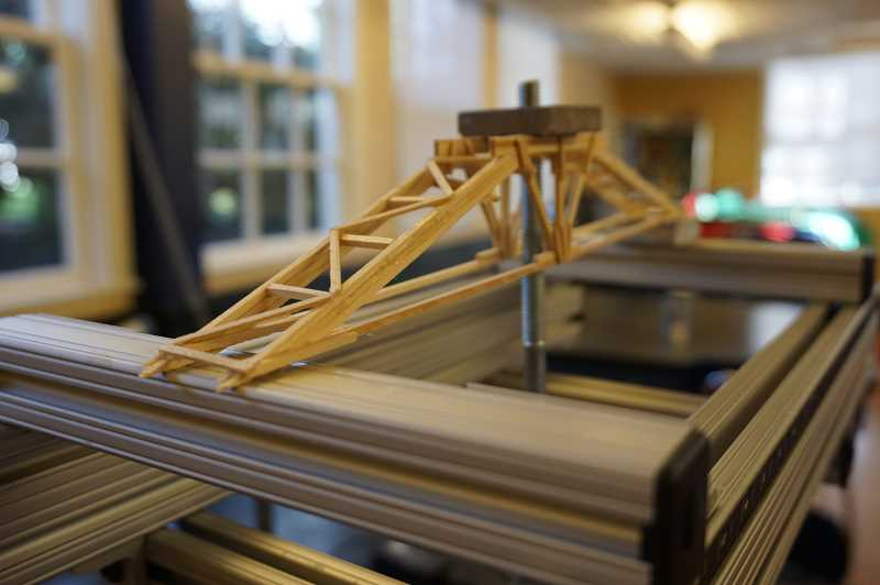 REVIEW PHOTO: CLAIRE HOLLEY - A bridge is tested using the Vernier structures and materials tester used by Riverdale bridge builders.