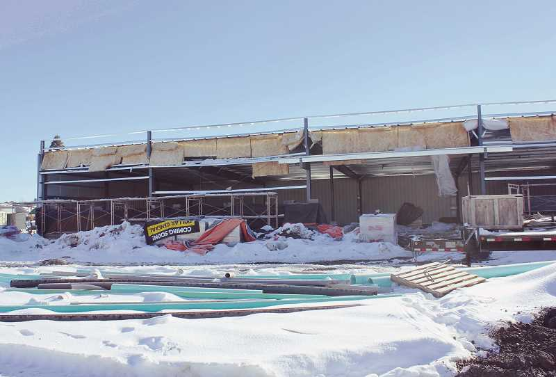 DESIREE BERGSTROM/MADRAS PIONEER - The walls are up, and the roof is on at the Culver Dollar General, which may open as early as the end of May.
