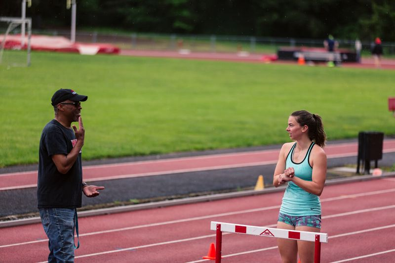 COURTESY: FLETCHER WOLD/THE ADVOCATE - Portlander Janna Vander Meulen, with coach Fernando Fantroy, works her hurdling training schedule around a full-time job at the Nike Sport Research Lab.