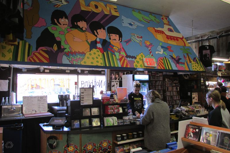 TRIBUNE PHOTO: JASON VONDERSMITH - The first song played at Music Millennium on March 15, 1969 was The Beatles' 'It's All Too Much,' which inspired owner Terry Currier to ask artist Hayley Cassatt to paint a 'Yellow Submarine' mural in the East Burnside store.