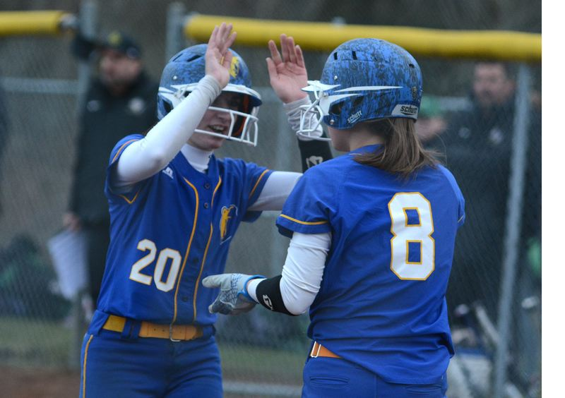 PMG PHOTO: DAVID BALL - Barlows Alexa Bailey (20) celebrates with teammate Sammie Pemberton after the two came in on a two-out single by Emily Virell to tie the score in the seventh inning.