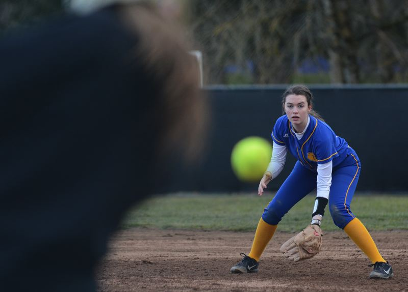 PMG PHOTO: DAVID BALL - Barlows Emily Virell gets ready for a bouncer toward first base.