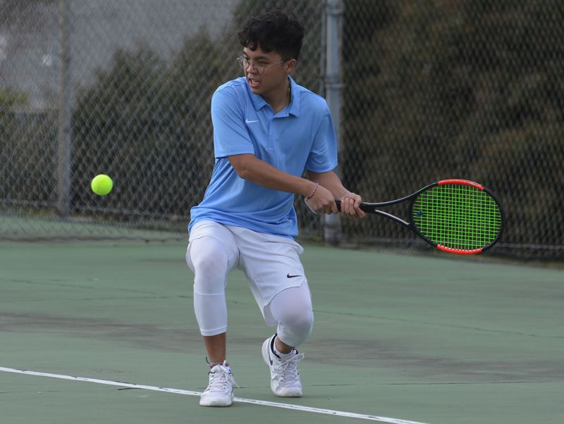 PMG PHOTO: DAVID BALL - Centennial senior Timothy Fu steps into a backhand during his 6-1, 6-2 win in No. 2 singles Wednesday against Sandy.