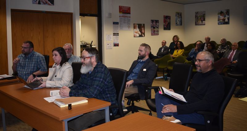 PMG PHOTO: TERESA CARSON - Members of a Mt. Hood Community College committee that studied bringing jazz radio station KMHD back to the college from OPB listen to questions from the college board of directors.