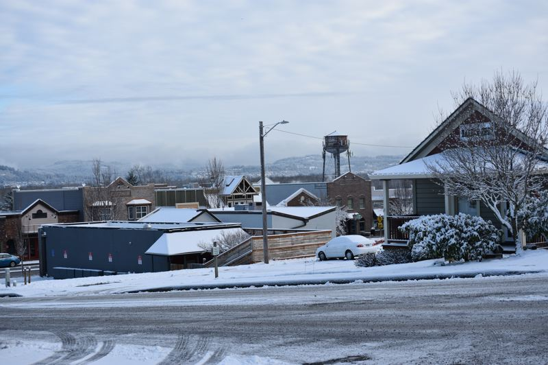 PMG FILE PHOTO: MATT DEBOW - A Troutdale street is lightly dusted with snow during a past  snowstorm. Updating a city ordinance will allow residents to ski on streets during winter weather.