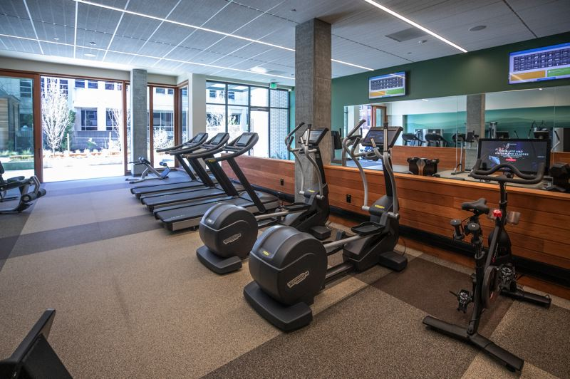 PAMPLIN MEDIA GROUP: JONATHAN HOUSE - The gym at the Carson North, shared with Carson South, which includes a Peloton exercise bike.