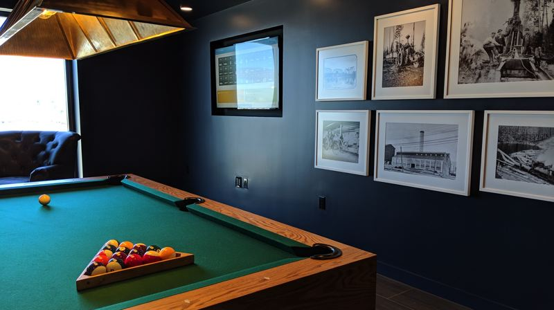 PAMPLIN MEDIA GROUP: JOSEPH GALLIVAN - The billiard room at the Carson North apartments at Northwest 21st and Savier in Slabtown. On the walls are vintage logging photos. The Carson Mill was a lumber mill in what is now Forest Park.