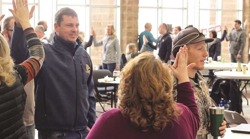 PHOTO COURTESY OF GRAYSON MUNN AND JAKE HUFFMAN  - Crook County Middle School and Crook County High School staff and district board members attended a CharacterStrong workshop earlier this month that focuses on servant leadership. They participated in a team-building exercise.