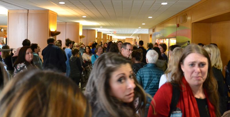 OREGON CAPITAL BUREAU/AUBREY WIEBER - After the March 14 hearing, the crowd of mostly opponents took to the halls, then the Capitol rotunda to grapple with the committee's approval.