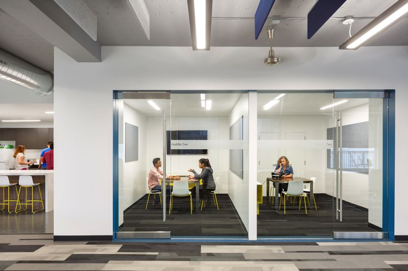 COURTESY: HENNEBERY EDDY - Open floor plans for company offices often create acoustics issues for employees, with interior designers usually handed the task of addressing the challenges.  Solutions may include features such as glass-walled phone and meeting rooms and private glazed offices.