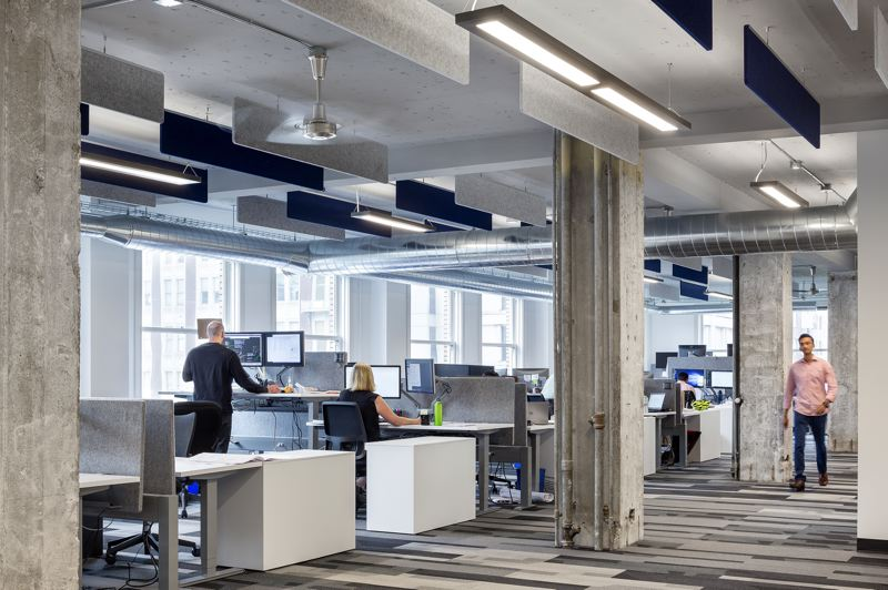 COURTESY: HENNEBERY EDDY ARCHITECTS - For its downtown Portland offices, Hennebery Eddy Architects tapped ceiling, furniture and floor strategies to help balance an open floor plan.