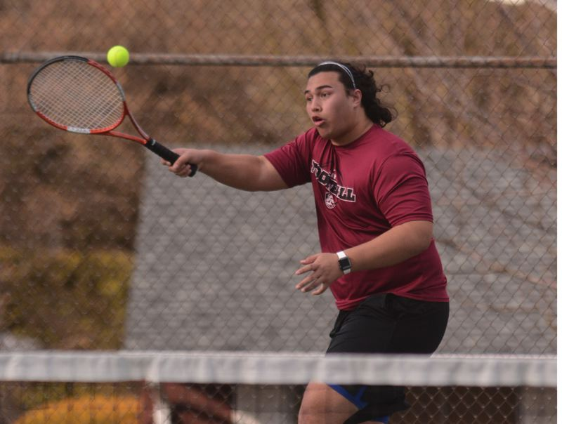PMG PHOTO: DAVID BALL - Sandys Talati Polamalu races across the middle of the court to hit a return in the Pioneers three-set win at No. 2 doubles Wednesday at Centennial.