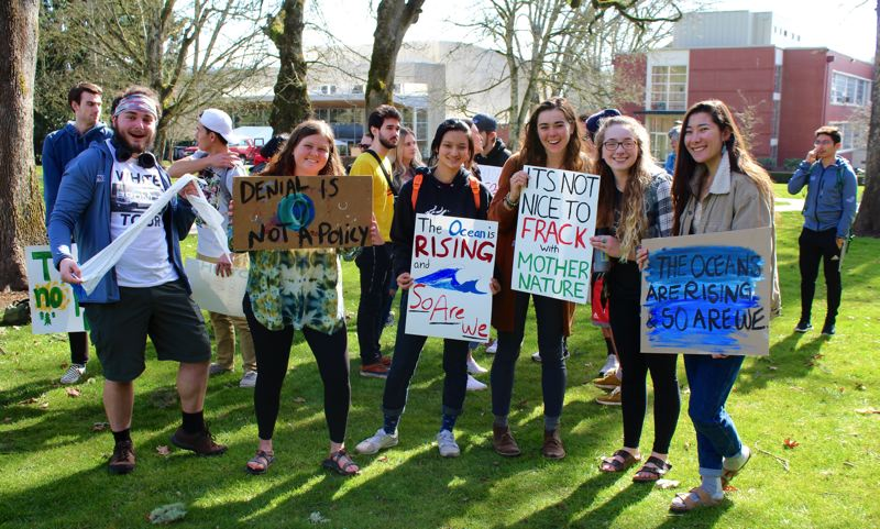 PMG PHOTO: OLIVIA SINGER - Students at Pacific University held up posters in protest of inaction on climate change during the Youth Climate Strike.