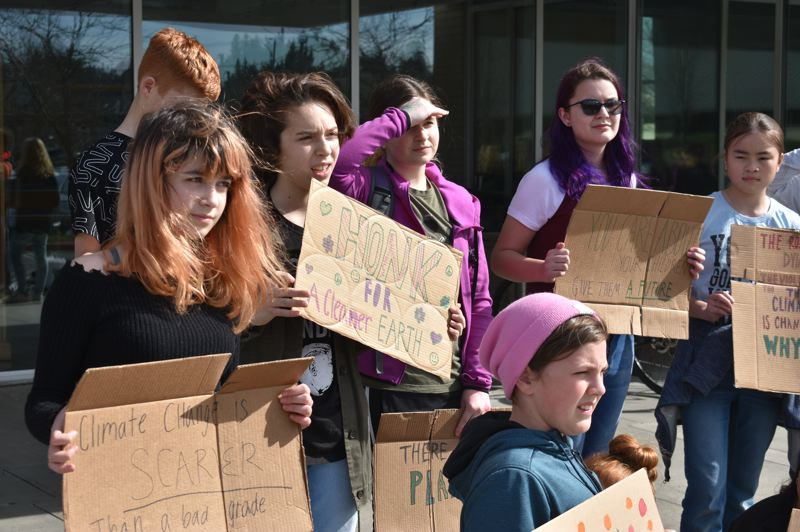 PMG PHOTO: TERESA CARSON - Students from Lewis and Clark Montessori Charter School in Damascus rallied in front of Gresham City Hall Friday to bring attention to climate change.
