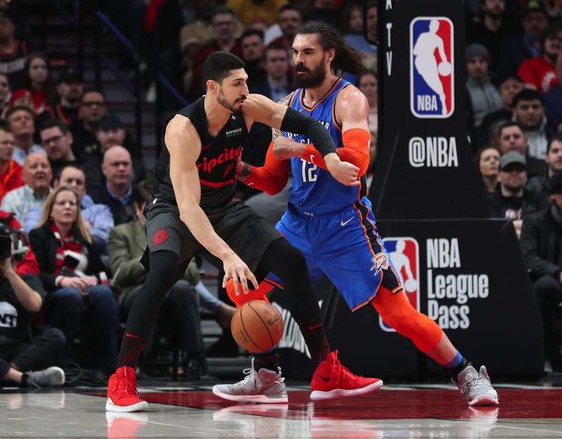PAMPLIN MEDIA GROUP: JAIME VALDEZ - Enes Kanter (left), a recent addition at center for the Trail Blazers, works in the low post against Steven Adams of Oklahoma City.