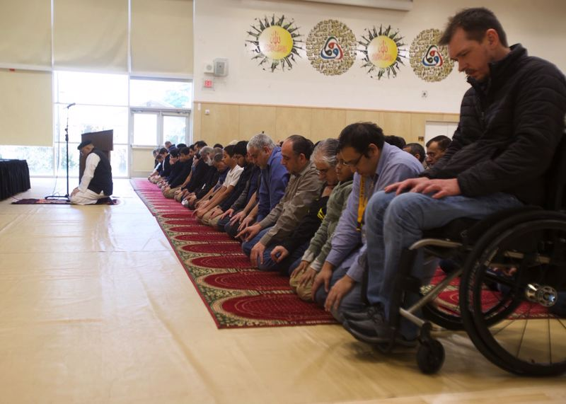 PMG PHOTO: JAIME VALDEZ - Friday prayers at the Muslim Educational Trust in Tigard were followed by a community outreach event. A terrorist attach at a mosque in New Zealand, hours earlier, resulted in at least 49 dead.