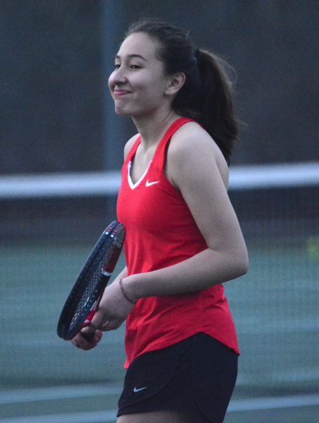 PMG PHOTO: DAVID BALL - Clackamas rookie Heidi Thiele flashes a smile after winning a point late in a three-set win at No. 4 doubles that clinched the Cavaliers dual victory.