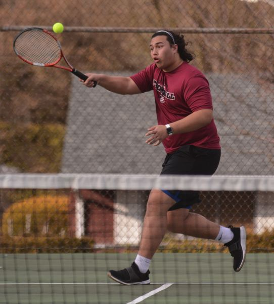 PMG PHOTO: DAVID BALL - Sandy's Talati Polamalu reaches a return at the net, as the Pioneers improved to 2-0 in league with a win over Gresham.