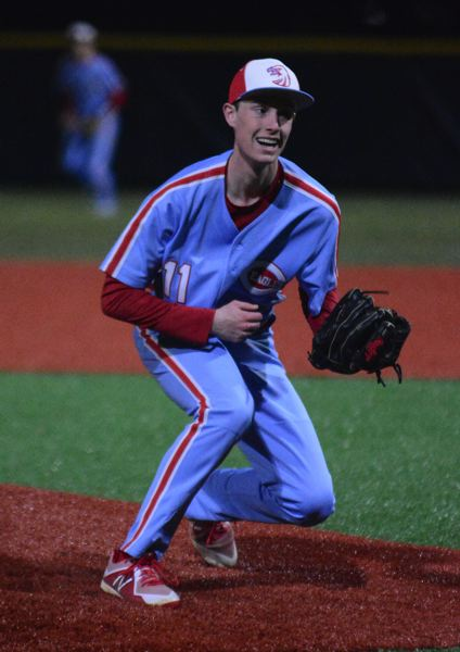 PMG PHOTO: DAVID BALL - Centennial pitcher Davis Landolt reacts after gloving a chin-high hopper on the mound during the Eagles 8-1 loss to Cleveland on Friday.