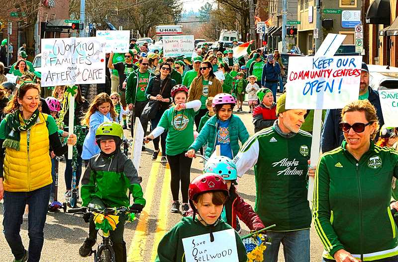 DAVID F. ASHTON - Scores of families who marched in the Sellwood St. Patricks Day parade on March 16 made clear their disapproval of the Parks Bureau plans to close down the Sellwood Community Center.