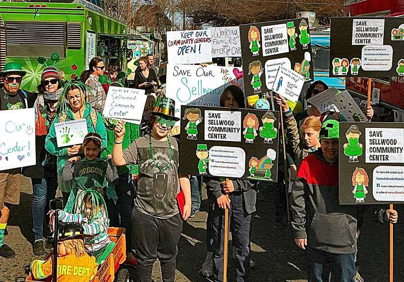 DAVID F. ASHTON - Although this parade group went back to St. Agathas for the St. Patricks Day celebration, they were not ready to stop protesting the Parks Bureaus announced plan to close down the Sellwood Community Center.