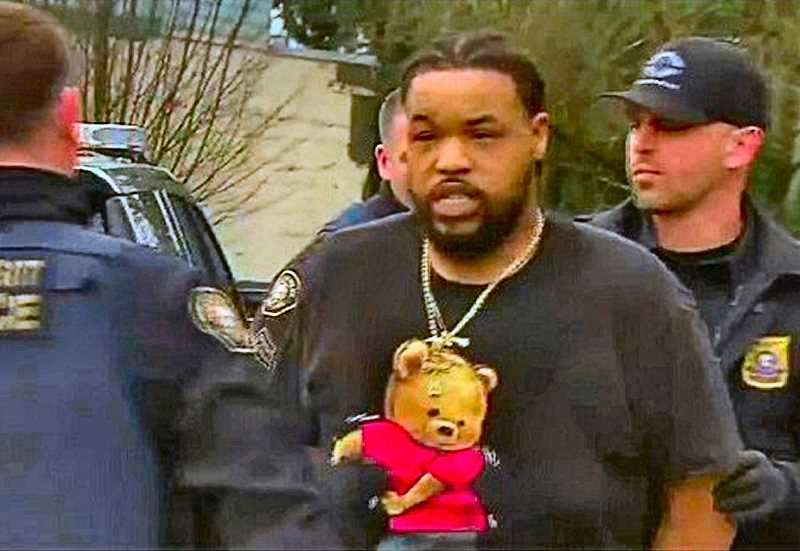 COURTESY KOIN TV-6 NEWS - Outside the 24-hour Fitness Super-Sport Gym on McLoughlin Boulevard in the Brooklyn neighborhood, State of Washington murder fugitive Thomas Earl Cooper, Jr., was taken into custody.