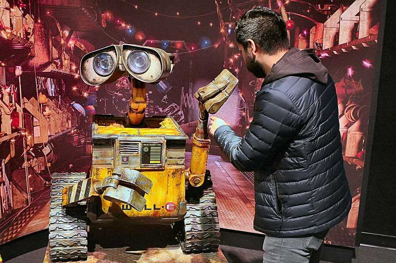 DAVID F. ASHTON - An OMSI guest gets a close-up look at the central character of the Pixar movie, WALL•E.