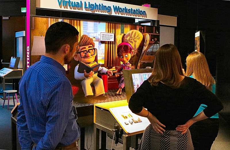 DAVID F. ASHTON - Visitors use hands-on to solve lighting challenges similar to what Pixar artists faced in creating the movie Up.
