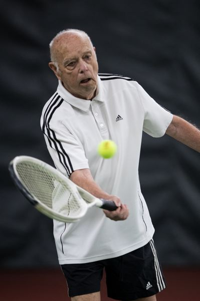 PAMPLIN MEDIA GROUP: JAIME VALDEZ - Ron Reynoldson battles it out against Steve Hall for more than two hours and over three sets in last week's 80s singles division of the Oregon State Senior Men's Indoor Championships at the Irvington Club.