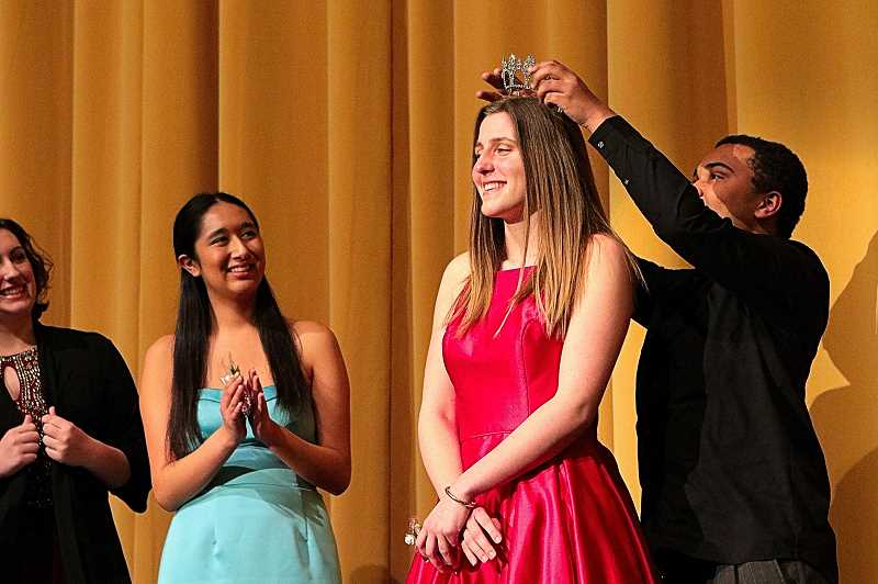 DAVID F. ASHTON - As her court looks on, 2019 Portland Rose Festival Cleveland High Princess Lindsey Hausafus receives her tiara is CHS Student Body President Peter Predisik.