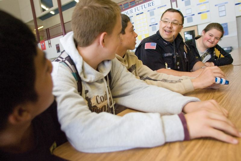 PMG FILE PHOTO - A school resource officer chats with Oregon students in this file photo