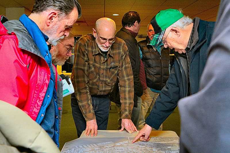 DAVID F. ASHTON - Along with many Sellwood residents, SMILE Transportation Committee Chair Scott Kelly (center) studied the maps showing where traffic calming speed bumps are to be installed.
