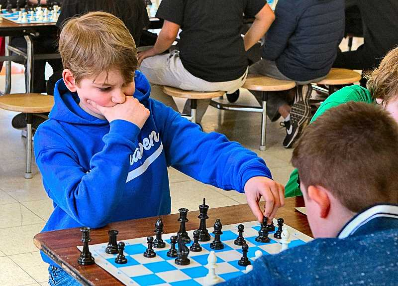 DAVID F. ASHTON - Otto, a student at Winterhaven School in Brooklyn, carefully considered his next move, during this Chess of Success regional tournament.