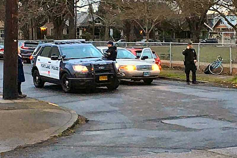COURTESY OF KPTV-12 NEWS - Officers spread out in the region around Richmond Elementary and Franklin High Schools on the morning of March 13, after two armed robberies less than an hour apart.