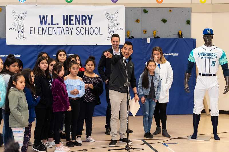 PMG PHOTO: CHRISTOPHER OERTELL - The Hillsboro Hops' Iván Hernández helps introduce their Latinx branding and name for the 2019 season during a school assembly at W.L. Henry Elementary School in Hillsboro, Ore., on Monday, March 18, 2019.