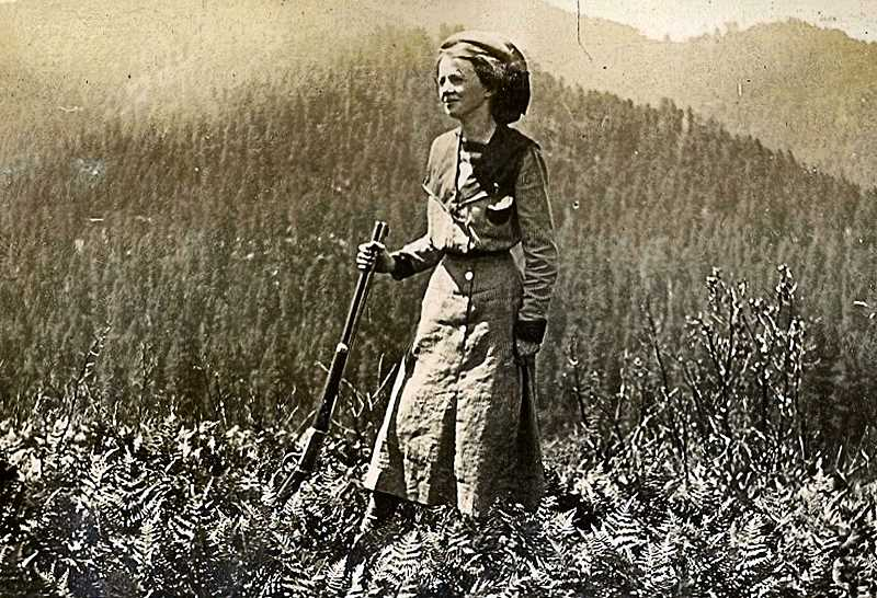 COURTESY OF TOM CUTSFORTH - Margaret Crosby (later Cutsforth), on a hillside with a rifle, outside the town of Riddle around 1911, on a camping trip at about age 15.