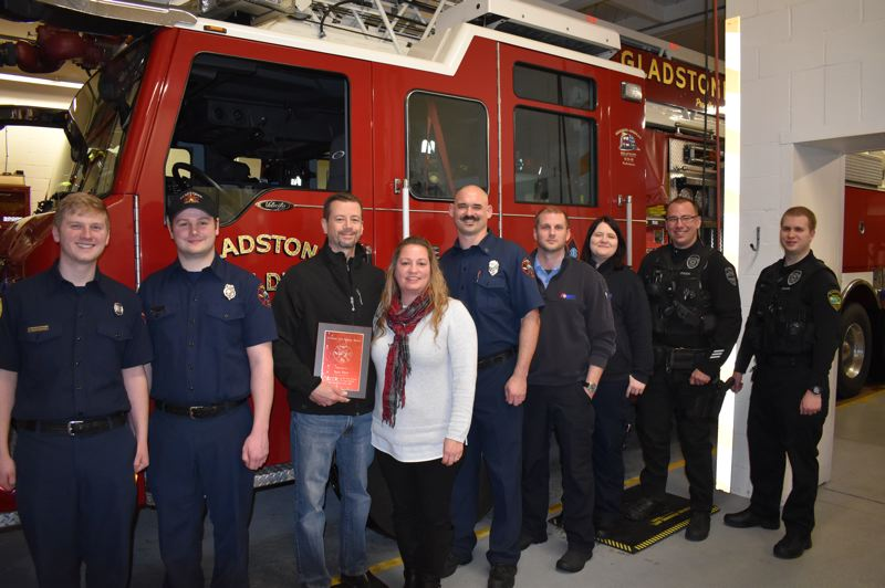 SUBMITTED PHOTO - During the lifesaving award presentation Feb. 12, Gladstone resident Sean Flett and emergency personnel were recognized for their hard work in response to a 911 call on Dec. 25.