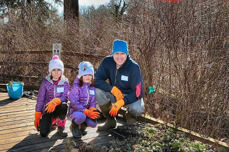 DAVID F. ASHTON - In Tideman Johnson Park, Addy, Vivi, and their dad Thatch Moyle say they came from their home in the Woodstock neighborhood to help out.