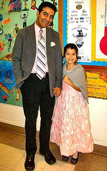 RITA A. LEONARD - Dad Oscar Merida and first grader Ofelia made a handsome couple.