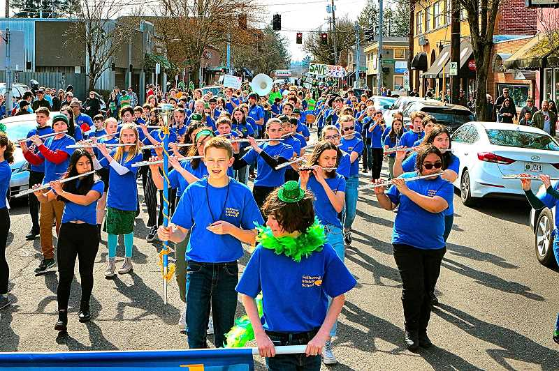 DAVID F. ASHTON - The Sellwood Middle School Band, under the direction of Dan Arrayan, filled the streets with lively music.