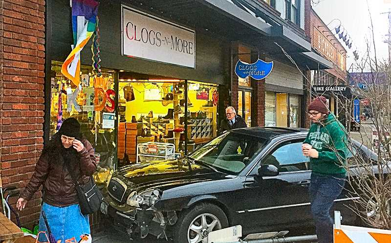 COURTESY OF HENRIK BOTHE  - The driver of the smashed car phoned for help, while passersby surveyed the damage.