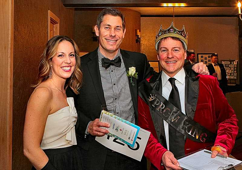 DAVID F. ASHTON - To begin their fun evening at this years Prom-styled Duniway Auction, Carrie and Curtis Spiteri bought a lucky raffle key from Prom King volunteer Dan ORielly (at right).
