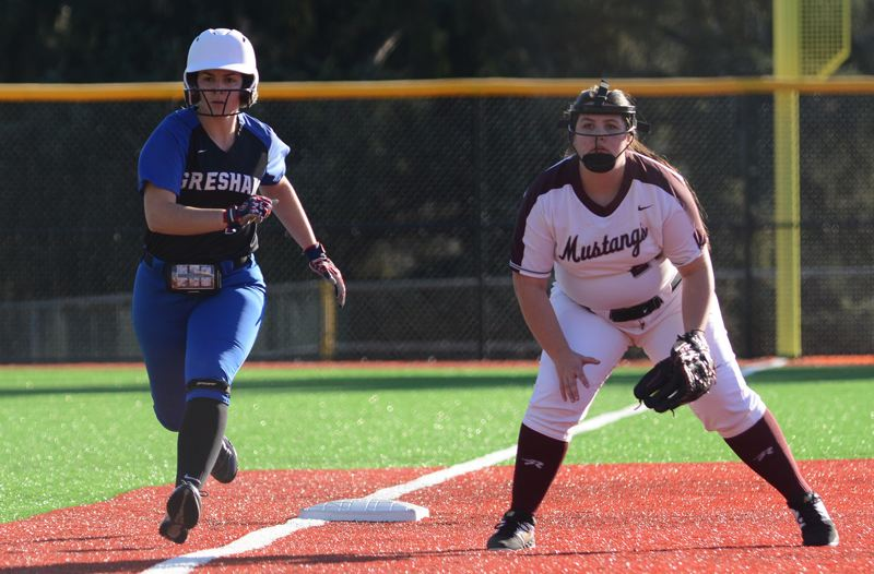 PMG PHOTO: DAVID BALL - Greshams Kyla Nannini gets a jump off third base on her way to scoring the games first run in the Gophers 13-0 win at Milwaukie on Monday.