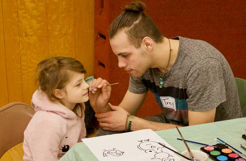 PMG PHOTO: CHRISTOPHER KEIZUR - Trey Slyapich, an ambassador with Nadaka Nature Park, painted faces during Welcome Back Vulture Day.