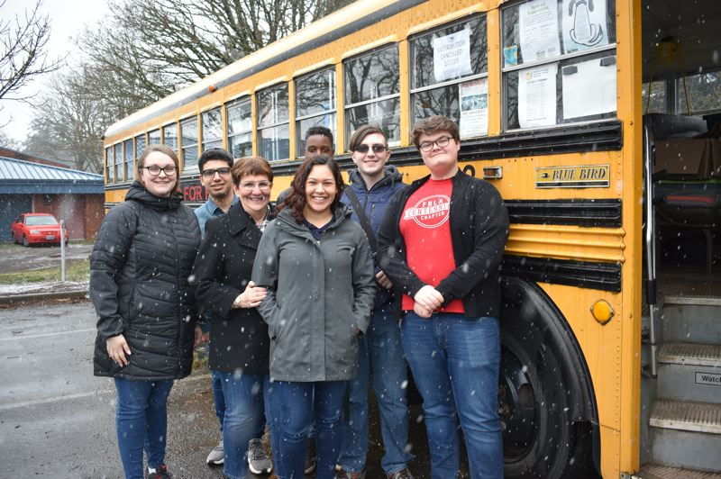 PMG PHOTO: TERESA CARSON - On a recent snowy day, some of the Food for Families crew showed up to tidy up the bus.