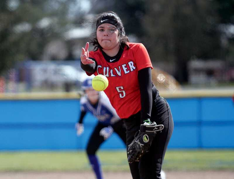 PHILLIP HAWKINS - Senior pitcher Nena Mendoza pitches at St. Paul on March 14, during a doubleheader. The Lady Dawgs showed their hitting strength, but lost to the Buckaroos 21-9 and 27-9.
