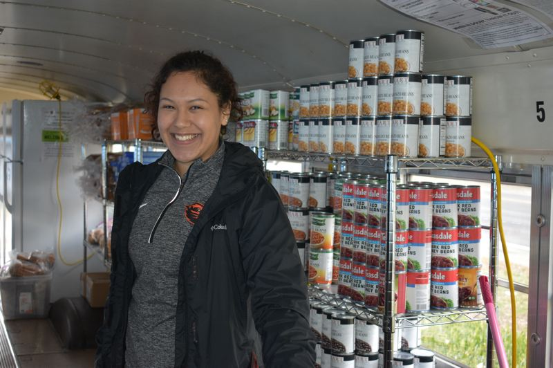 PMG PHOTO: TERESA CARSON - Pantry coordinator Garcia is all smiles before the clients come to shop.